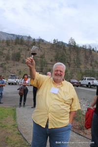Providing guidance to the new owners, industry guru Harry McWatters toasts Fort Berens at flag raising.