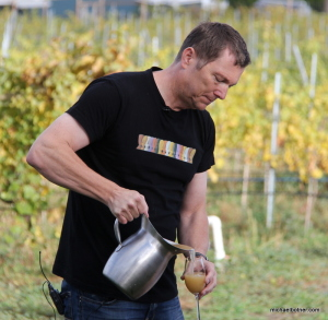 Eric von Krosigk, Summerhill's viticulturist and winemaker, pours the young, froth federweisser into a glass.