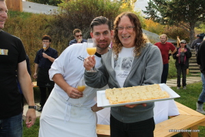 Jesse Croy, executive chef of the Sunset Organic Bistro (left) prepared a scrumptious caramelized onion tart to accompany the young fermenting wine. Owner Stephen Cipes holds a tray offering onion tart slices.