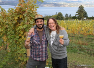 Ari Cipes, vineyard worker and youngest son of Stephen Cipes, owner of Summerhill Pyramid Winery (right), toast the harvest in the vineyard with a glass of the young wine